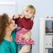Small young girl at doctor — Stockfoto