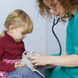 Girl in medical study studying plush toy - Stockfoto
