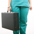 Woman chained to leather suitcase — Stock Photo