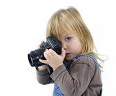 Young girl try to shooting photos — Stock Photo