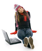 Woman in winter clothes with laptop — Stock Photo