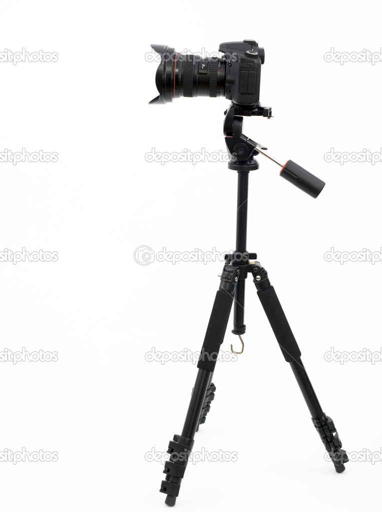 Silhouette of professional digital photo camera on a tripod, white background — Stock Photo #1812725
