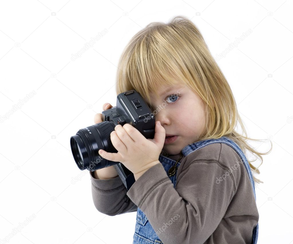 Young girl, child, trying to shoots photos onn white background — Stock Photo #1813923