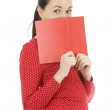 Woman covering face by book — Stock Photo