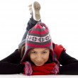 Lying girl in winter clothes - Foto Stock