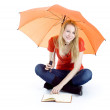 Young woman with umbrella and book — Stock Photo