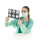 Doctor looking at tomography brain — Stock Photo