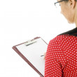 Woman writing on clipboard — Stockfoto