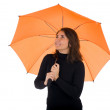 Stock Photo: Young woman with orange umbrella