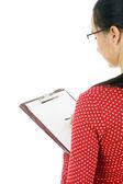 Woman writing on clipboard — Stock Photo
