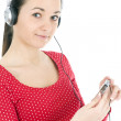 Young girl listening music from mp3 — Stock Photo #1958181