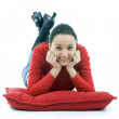 Young woman lying on the red pillow — Stock Photo #1958265