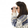 Beautiful girl using binoculars - Stock Photo