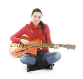 Young woman playing electric guitar — Stock Photo