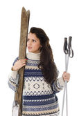 Woman with old wooden alpine skis — Stock Photo