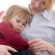 Small girl sitting on knees at mum — Stock Photo #2165660