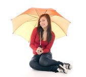 Young woman with orange umbrella — Stock Photo