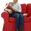 Small young girl sitting on knees at mum — Stock Photo #2200496