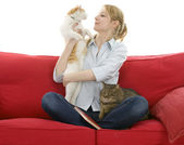 Young woman with two cats — Stock Photo