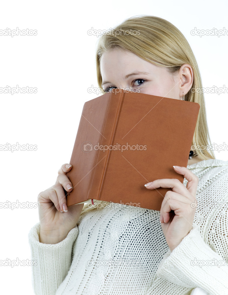 Book Covering Face : Girl covering face book — stock photo photomak