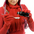 Young woman with spoon of syrup - Stock Photo