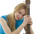 Young woman with electric guitar — Stock Photo