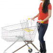 Stock Photo: Young womwith shopping cart