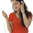 Young girl listening music from mp3 — Stock Photo #2252935