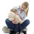 Little girl with mother and teddy — Stock Photo