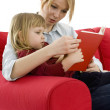 Mother and daughter reading - Stock Photo