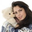 Smiling young woman with teddybear — Stock Photo