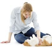 Young woman playing with cat — Stock Photo