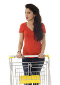 Young woman with shopping cart — Stock Photo