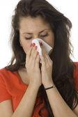 Woman sneezing in the handkerchief — Stock Photo
