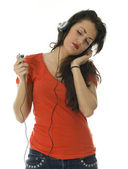 Girl listening music from mp3 player — Stock Photo