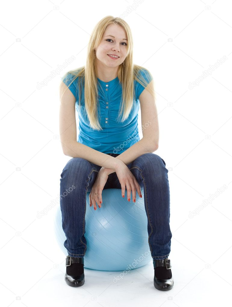 Smiling young woman on blue ball, white background — Stock Photo #2252009
