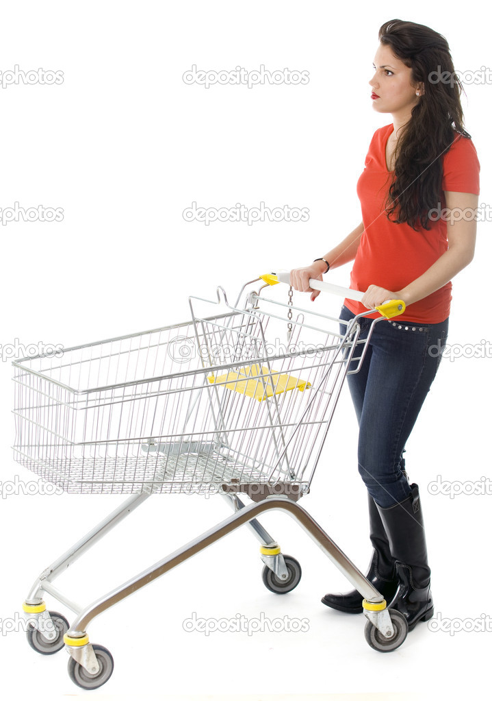 Standing young woman with empty shopping cart — Stock Photo #2252812