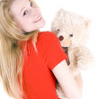 Smiling woman with teddybear — Stock Photo