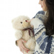 Stock Photo: Young woman with teddybear