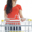 Young woman with shopping cart — Stock Photo #2374623