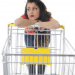 Young woman with shopping cart — Stock fotografie