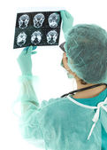 Lady doctor looking at tomography brain — Stock Photo