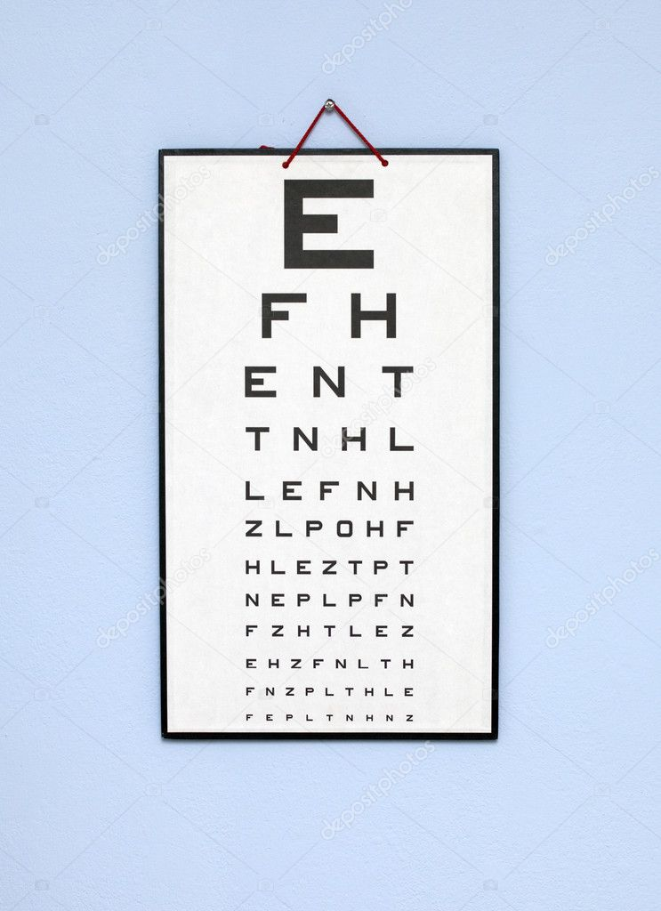 Eye test chart - white optometry chart on the blue wall  Stock Photo #2426494