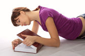 Young student reads the book — Stock Photo