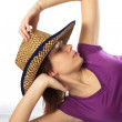 Woman under a cowboy's hat — Stock Photo #1949899