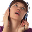 Girl in ear-phones listens to music — Stock Photo #1949901