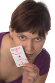 Young girl holds a playing card — Stock Photo
