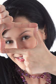 Beautiful girl shows hands a rectangle — Stock Photo