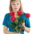 Woman holds bouquet of red roses — Stock Photo