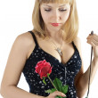 Beautiful woman holds red roses — Stock Photo